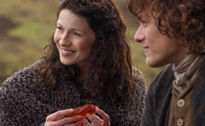 Claire holds Munro's wedding gift of a dragonfly in amber image credit: Outlander Starz, Sony Pictures Television