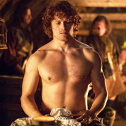 Jamie_sitting_shirtless_indignant_tavern_Rent