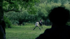 Jamie and Black Jack duel as Claire looks on