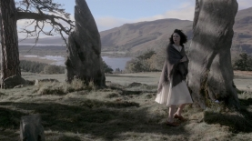 Claire hears strange buzzing sound (Loch Rannoch behind), ep101. Image STARZ & Sony Pictures Television, via Outlander-Online.com