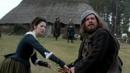 Claire, Rupert in goat tug-of-war; Highland Folk Museum, ep105. Image STARZ Sony Pictures Television, via Outlander-Online.com