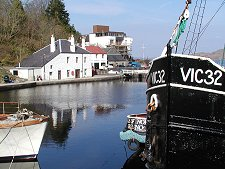Crinan-Coffee-Shop-from-across-basin-Vic32Puffer-foregrnd_Undiscovered-Scotland